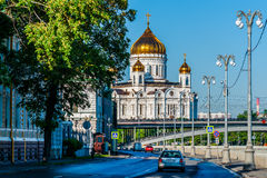 Sophia embankment in the morning. MOSCOW, RUSSIA - MAY 25, 2015: Sophia embankment of the Moscow river. Large Stone bridge and the Cathedral of Christ the Savior Royalty Free Stock Images