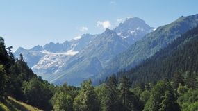 Sophia glacier. Located in the Western Caucasus nature reserve, the blue sky, Rocks Stock Images