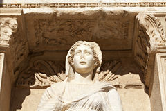Sophia Goddess of Wisdom Ancient Statue. Ancient marble statue of a woman looks out under intricate archway copy space (statue is Sophia, Goddess of Wisdom, at Royalty Free Stock Photos