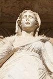 Sophia Goddess of Wisdom Ancient Statue. Ancient marble statue of a woman looks out under intricate archway copy space (statue is Sophia, Goddess of Wisdom, at stock photo