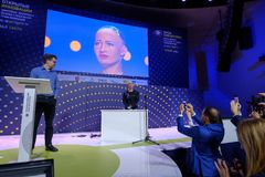 Sophia humanoid robot at Open Innovations Conference at Skolokovo technopark. Moscow, Russia - October 16, 2017: Sophia humanoid robot and David Hanson at Open Royalty Free Stock Photography