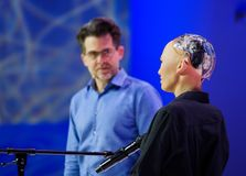 Sophia humanoid robot at Open Innovations Conference at Skolokovo technopark. Moscow, Russia - October 16, 2017: Sophia humanoid robot and David Hanson at Open Stock Images