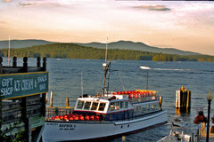 Sophie C. mailboat on Lake Winnipesaukee. The Motor Vessel (M/V) Sophie C. is the oldest floating post office in the United States. Each season she provides mail Stock Photography