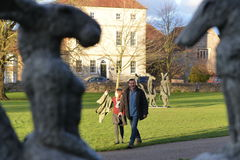Sophie Ryder Art Exhibition at Salisbury Cathedral. SALISBURY, UK - FEBRUARY 11, 2015: Passersby view artwork by the renowned sculpture Sophie Ryder as part of Royalty Free Stock Images