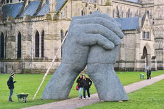 Sophie Ryder Art Exhibition at Salisbury Cathedral. SALISBURY, UK - FEBRUARY 11, 2015: People walk under an artwork by the renowned sculptor Sophie Ryder as part Stock Photo