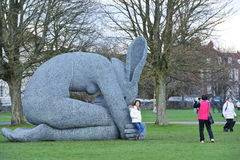 Sophie Ryder Art Exhibition at Salisbury Cathedral. SALISBURY, UK - FEBRUARY 11, 2015: A tourist poses for a photo with artwork by the renowned sculptor Sophie Stock Photography
