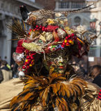 Sophisticate Venetian Disguise. Venice,Italy- February 18, 2012: Portrait of a person wearing a very sophisticate Venetian disguise during the Venice Carnival Stock Photo