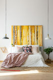 Sophisticated bedroom with contemporary artwork. Contemporary yellow artwork in sophisticated bedroom with pastel color scheme Stock Photo