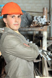 Sophisticated builder. Industrial theme: a blue collar working at a manufacturing area Stock Photography
