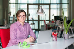 Sophisticated Business Lady in modern Digital Office Interior. Sophisticated Business Lady in smart casual Style Clothing working at modern Digital Office Stock Photo