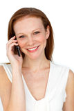 Sophisticated businesswoman on phone. Isolated on a white background stock photography