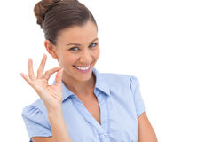 Sophisticated businesswoman saying ok. With fingers stock images
