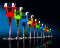 Sophisticated cocktails. A set of colourful sophisticated cocktails on a black and blue backgorund royalty free stock photo