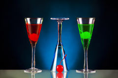 Sophisticated cocktails. A set of colourful sophisticated cocktails on a black and blue backgorund royalty free stock photography