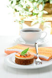 Sophisticated Dessert. A non traditional carrot cake served with fresh coffee Stock Image