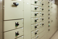 Sophisticated electrical switch gear. Is neatly designed in panels in the plant room stock images