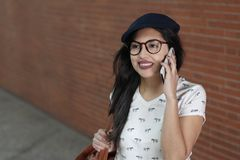 Sophisticated female entrepreneur calling by phone.  Stock Photography