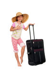 Sophisticated girl. A young girl with large straw hat and suitcase, playfully pretending to be grown up and sophisticated Stock Photos