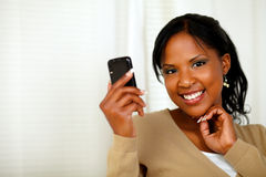 Sophisticated lady reading a message on cellphone Royalty Free Stock Photography