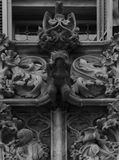 Sophisticated lizards on the balcony part 2. Shot in black and white detail of the sculpture on the facade of this historic building representing some characters stock photos