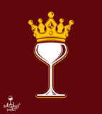 Sophisticated luxury wineglass with golden imperial crown. Leisu Stock Images