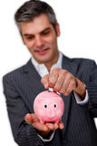 Sophisticated male executive saving money Royalty Free Stock Photos