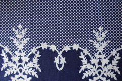 Sophisticated old fashioned pattern on blue fabric. From above Royalty Free Stock Image
