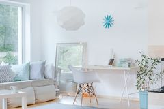 Sophisticated room design. Picture of sunny sophisticated studio room design royalty free stock photo