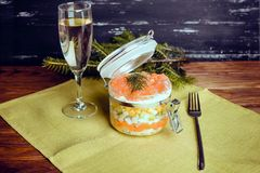 Sophisticated salad with champagne and fork on a wooden background Royalty Free Stock Images