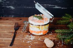 Sophisticated salmon salad with parmesan and fork on a wooden background Royalty Free Stock Image