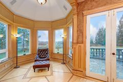 Sophisticated sitting space with spectacular view. Sophisticated sitting space features a bay window accented with marble windowsills illuminated by elegant Stock Photos