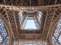 Sophisticated structures of Eiffel tower in Paris. PARIS - SEPTEMBER 28: Sophisticated and amazing architecture of Eiffel tower metal structure, in Paris, France royalty free stock photography