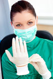 Sophisticated surgeon wearing scrubs and a mask. Looking at the camera in a hospital Stock Photo