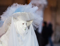Sophisticated Venetian Disguise. Venice, Italy- February 26th, 2011: Image of a person wearing a sophisticated Venetian costume and mask during the Venice royalty free stock images