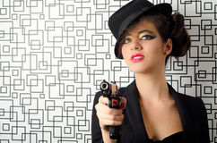 Sophisticated woman. Holding a gun in her hands Stock Image