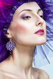 Sophisticated woman. A sophisticated woman with purple makeup and jewelry Royalty Free Stock Photos