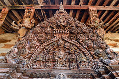 Sophisticated wooden carving on a Hindu temple. Kathmandu, N. Sophisticated wooden carving on a Hindu temple in Kathmandu, Nepal stock image