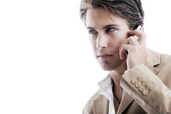 Sophisticated young businessman on the phone. Close-up portrait of a young sophisticated businessman talking on a mobile phone Stock Photography