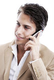 Sophisticated young man talking on the phone Stock Images
