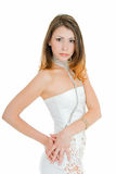 Sophistication. Young adult beauty girl in dancing pose on white royalty free stock images