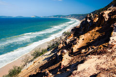 Soplo de la arena de Carlos en la playa del arco iris fotos de archivo libres de regalías