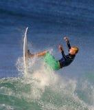 Soplo de Mick del campeón del mundo que practica surf Imágenes de archivo libres de regalías