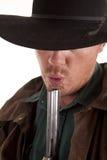 Soplo del vaquero en el arma Imagen de archivo libre de regalías