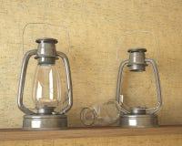 Soporte de dos lámparas de aceite en un estante Imagenes de archivo