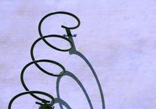 Soporte de la bici con la sombra Imagen de archivo libre de regalías
