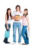 Soporte de los estudiantes con el cuaderno y los paquetes amarillos Fotografía de archivo