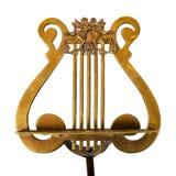 Soporte de música antiguo, bronce, en el fondo blanco Imágenes de archivo libres de regalías