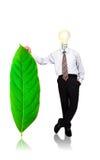 Soporte del hombre de negocios con la hoja verde Fotografía de archivo libre de regalías