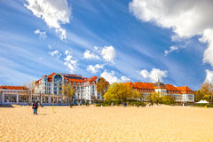 Sopot Baltic beach. People relaxing on beach on the second plane beautiful architecture of Sopot, on May 03, 2016 in Sopot, Poland Stock Photography
