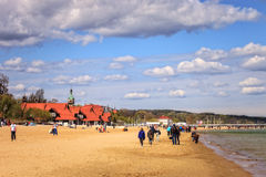 Sopot beach. Baltic coast beach scene of many people walk, relaxing and enjoying, on May 02, 2015 in Sopot, Poland Stock Image